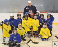 Tomáš Fleischmann a přípravka hokejové Kopřivnice